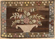 American hooked rug with a basket of flowers, 26'' x 39''. - Price Estimate: $140 - $240
