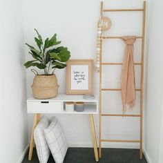 cute to have a quote, plant and some homely touches to the entrance way