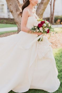 Red and ivory wedding bouquet: http://www.stylemepretty.com/california-weddings/2017/03/17/a-wedding-shoot-inspired-by-beauty-and-the-beast/ Photography: Damaris Mia - http://www.damarismia.com/
