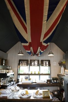 """cafe with oversized """"Union Jack"""" flag suspended from the ceiling"""