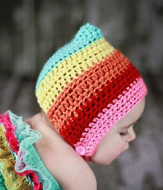 Rainbow pixie hat. No pattern. This lady had some awesome baby and toddler hat patterns for sale. On this site.