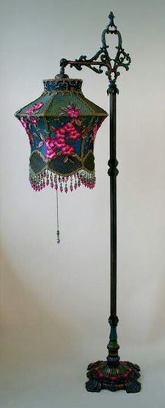 painted bridge lamp holds a Cherry Blossom Lantern shade dyed green to blue and covered in vibrant fuschia colored vintage silk cherry blossom appliques and gold mesh. The bottom is adorned with fancy little flower beads. This shade would also work Victorian Lamps, Antique Lamps, Antique Lighting, Vintage Lamps, Luminaire Original, Lace Lamp, Lampe Art Deco, I Love Lamp, Chandelier Lamp