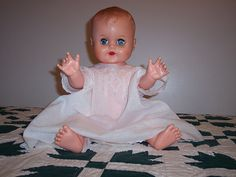 I have a doll like this that I received when I was about 2 years old.  She sits on top of my cedar chest in my bedroom.