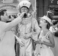 """""""Anaheim — Eddie Fisher, a host at the opening of Walt Disney's """"Disneyland"""" where he served on the Coca-Cola refreshment corner, gives a drink to aluminum clad spaceman Don MacDonald as Debbie Reynolds looks on Disneyland Opening Day, Disneyland Photos, Disneyland Park, Disneyland Tomorrowland, Magical Pictures, Life Pictures, Disneyland Vintage, Walt Disney, Disney Parks"""