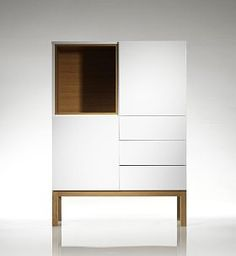 A high-gloss white finish and striking oak detailing make the Nash cabinet range an ultra-stylish storage solution in your home. This striking highboard is a modern way to store and display items in any room.