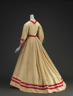 1868, America - Dress - Alpaca, velvet ribbon and covered buttons, silk tassels, cotton linen inner bodice, glazed cotton lining, and metal closure