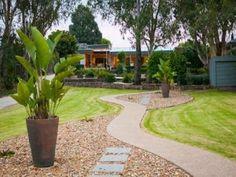 low maintenance garden design using grass with retaining wall hedging gardens photo 1276052
