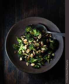An easy recipe for curried roasted broccoli, sprinkled with lemon juice and topped with toasted almonds. A fantastic side dish!