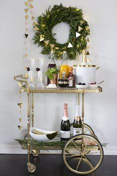 - Having a bar cart around can help you organize beverage and food. By definition a bar cart is usually a table with four wheels, intended for drink ser. Diy Bar Cart, Gold Bar Cart, Bar Cart Styling, Bar Cart Decor, Bar Carts, New Years Eve Decorations, Outside Bars, Champagne Bar, Bubbly Bar