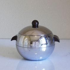 My grandparents had one of these in their kitchen when I was growing up and it was passed down to me by my father.  I use it as a cookie jar.  I cherish this.