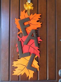 DIY Fall Leaf Dollar Door Wreath | 21 DIY Fall Door Decorations, see more at http://diyready.com/21-diy-fall-door-decorations-wreaths-door-hangers-more