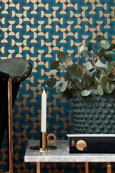 A geometric circular wallpaper design with a gold shimmering effect.