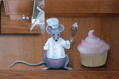4 inch high House Mouse. Painted on baseboard. Inset on top left shows size comparison