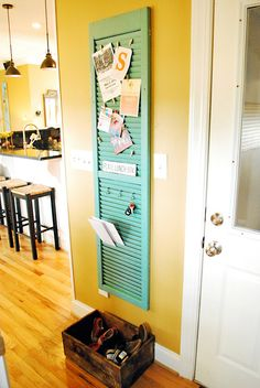 Shutter for kitchen - clothespins for invites and mail and hooks for keys! This would work beside the garage door!