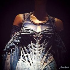 "Gaultier garment, looks quite inspired by ""skeleton corsets"", though without doing any shaping to the figure."