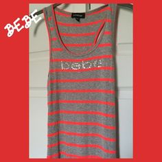 BeBe Racerback Maxi Dress with Side Slits Size: M. Super comfy racerback tank maxi. Ribbed soft gray material with bright flamingo colored stripes. Side slits up to about the knee on both sides on the bottom. Shown in last pic. BeBe logo in the center in rhinestones. Great spring and summer dress. Pair with sandals or flip flops. Super cute! bebe Dresses Maxi