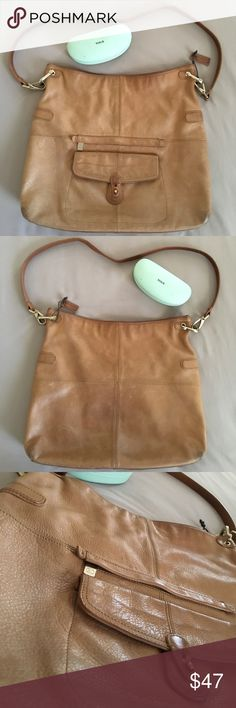 """Liz Claiborne leather tote Large leather tote by Liz Claiborne. 15"""" x 14"""" x 2 3/4"""". Magnetic closure and front pouch. Extremely soft and supple leather. Has some marks on the shell, interior is a very soft suede-like texture, and very clean with 5 pockets. Happy to answer any questions. Thanks! ‼️ Liz Claiborne Bags Totes"""