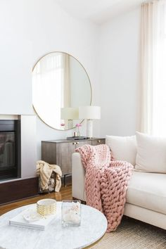 MARIANNA HEWITT HOME TOUR | LIVING ROOM - SECTIONAL COUCH - CHUNKY KNIT BLANKET  - MARBLE TABLE - GALLERY WALL - HIGH CELINGS - NEUTRAL COLORS - BLUSH PINK  - ROUND MIRROR