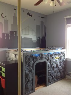 Superhero bed - Bat Cave bed in Brooks room. Used Ikea Kura bed, and designed from there...