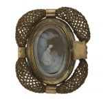 Georgian Mourning Pin. Under the thick beveled crystal is an expertly rendered shell cameo of a grieving woman at the grave site of her beloved. The cameo is framed and then surrounded by woven hair of the dear departed. Late 18th to early 19th century.