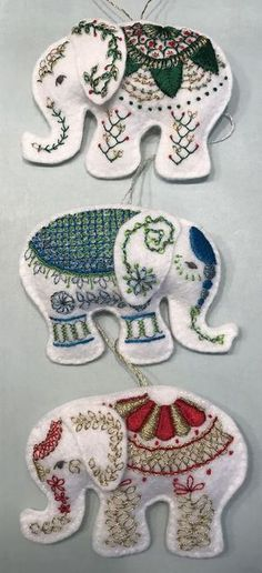Elephant Holiday Christmas Ornaments made from wool felt and hand embroidered using DMC Satin Floss, DMC Light Effects and DMC Metallic floss. Hand stitched with Lattice Stitch, French Knot, Lazy Daisy, Buttonhole Circle, Satin Stitch, Threaded Backstitch, Scalloped Buttonholed Chain Stitch, Feathered Chain Stitch, Guilloche Stitch. DMC Satin Floss and DMC Light Effects floss