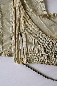 Corset  Date:     1805–10 Culture:     French (probably) Medium:     silk, metal, baleen Dimensions:     Length at CB: 5 in. (12.7 cm) Credit Line:     Gift of Mr. J. C. Hawthorne, 1946 Accession Number:     C.I.46.82.8