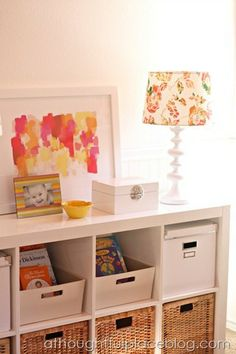 organized bookshelves, Ikea Expedit,  I like the half height baskets for books