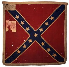 "Battle Flag of the 18th Mississippi Infantry Regiment. Captured by the 77th New York on May 3, 1863, during the Chancellorsville Campaign. When organized it had 1,100 men. At First Manassas there were 800 men. March 1865, there were 100 men and five officers present for duty. The regiment had then been engaged in sixteen battles. In the spring of 1864, when the two years enlistment expired, the regiment and the whole brigade unanimously re-enlisted for ""forty years or the war."""