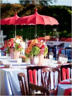 Continuing to use the umbrellas as part of the wedding decor is a great idea. Creating artistic and unique centre pieces will mean your wedding will be one to remember.
