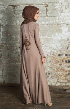 SUNSET NEEM ABAYA - A favourite cut that suits all adorned with the beautiful Neem motif on the lower back and cuffs. A soft Sunset Pink with pink coffee embroidery, a beautiful piece to compliment the season.