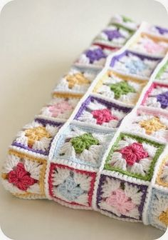 Crochet Afghans Design The page for this actual granny square afghan does not exist? I am confident that I could replicate the design shown with your standard crochet granny square pattern. Very pretty. Crochet Motifs, Crochet Quilt, Granny Square Crochet Pattern, Crochet Squares, Crochet Blanket Patterns, Crochet Granny, Crochet Yarn, Knitting Patterns, Granny Squares