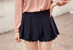 black skirt with lace and pink shirt tucked in