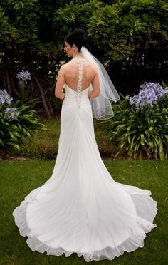 This wedding dress  is absolutely gorgeous.  It is Brand NEW and in pristine condition, as it has never been worn.   This white dress is made in delicate chiffon and designed with beautiful beaded straps. The straps merge into the back of the dress, leaving it uncovered. It is an A-line wedding dress that has a V-neck. The bodice features soft drapes from the beaded strap. The skirt has a half-train.    This dress was never worn or never altered, so you can have it altered to your liking. I…