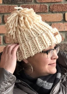 Free Knitting Pattern for Snowboarder Chunky Hat by Marly Bird - Inspired bythe hat worn by gold medal winner Chloe Kim, this ribbed beanie topped by floppy Pom Pom can be knit inunder 2 hours, according to the designer, Marly Bird. Rated easy by Ravelrers,