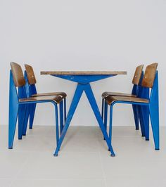 Compass table (1953) and Standard dining chairs (1950) by Jean Prouvé. Materials bent sheet steel, enameled steel, beech plywood and aluminium. / Sign Tokyo