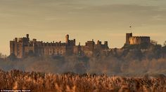 Picturesque:Arundel Castle looked stunning in West Sussex this morning as the sun rose to burn off any early morning mist in the area