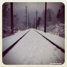 Snowy Train Tracks.
