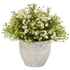 Indoor/outdoor silk mini daisy plant in a weathered pot.   Product: Faux floral arrangementConstruction Material:
