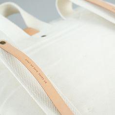 Textile, fabric, white, bag, stitched, detail, washable paper, branding, label, stud