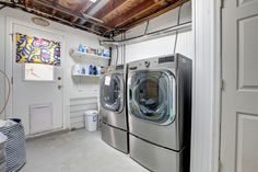 Laundry room with new appliances and plenty of room for storage