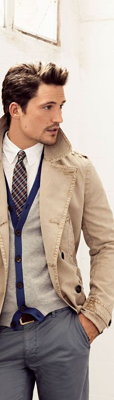 Shop this look for $174:  http://lookastic.com/men/looks/trenchcoat-and-dress-shirt-and-cardigan-and-belt-and-chinos-and-tie/1300  — Tan Trenchcoat  — White Dress Shirt  — Grey Cardigan  — Brown Leather Belt  — Grey Chinos  — Brown Plaid Tie