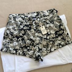 """Floral premium denim shorts Beautiful floral premium denim shorts. Brand new. Four front burnished buttons, five pockets and high waisted.  14"""" across waist.  10"""" front rise.  11"""" long.  2"""" inseam.  Black, cream, gray and khaki. Forever 21 Shorts"""