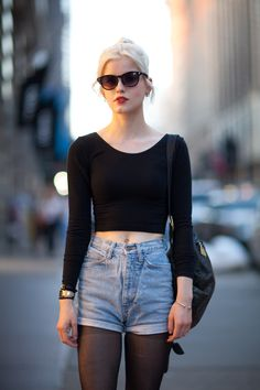 cropped black top + denim shorts = off duty style inspiration