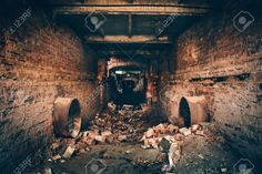 Picture of Old dark creepy underground brick tunnel or corridor or sewer pipeline at abandoned ruined industrial factory, dark retro toned stock photo, images and stock photography. Abandoned Houses, Abandoned Places, Sewer System, Adventure Map, Catacombs, Dark Places, Scenic Design, Land Art, Corridor