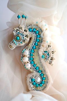 Hand beaded seahorse, pearls and mixed beads.