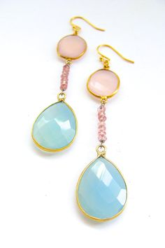 Gold Chalcedony Earrings! At the top of each earring is a pale pink chalcedony, bezel set in 14k gold, hanging from gold plated earwires. Dangling from the bezel set stone is a short strand of small pink tourmaline beads, and at the bottom of hangs a light blue chalcedony pendant, also bezel set in 14k gold. $49.00