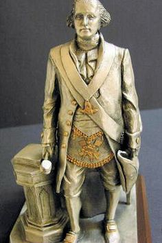 This beautiful pewter statue of George Washington depicts him wearing his Watson-Cassoul Masonic Apron and standing in the East governing Alexandria Lodge ...