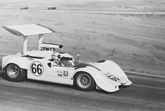 Jim Hall in his Chaparral 2G during the 1968 LA Times GP Can-Am. Hall, who had the speed to compete with the factory McLarens, suffered a broken brake line fitting, leaving him with front brakes only. Still, despite a long pit stop was able to finish 3rd. Dave Friedman photo.