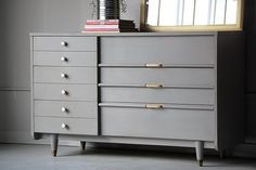 I love this gray dresser.  Nice painted mid century look.