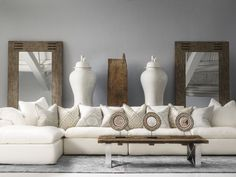 Truman Sectional Sofa in white linen with Cushions in Kingdom Powder, Volcano Powder, Glacier Powder, Kingdom Canvas, Volcano Canvas, Tobias Mirrors and Petipa Coffee Table.